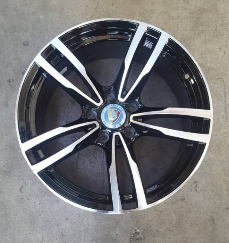 BMW or Holden 18x8 23p 5/120 Black with polished face mags x 4