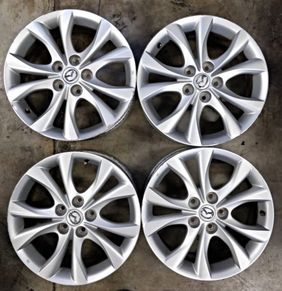 set of 4 Late model Mazda 17x7 5/114.3 52.5p s/hand mags 2 small marks suit 3, 6