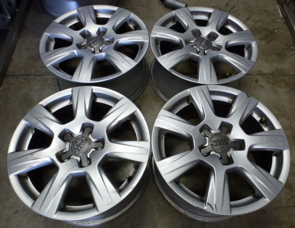 Audi A4 A3 16x7.5 5/112 45p factory mags nice 7 spoke wheels some kurb marks