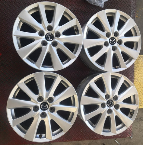 "4 secondhand 17"" mags to suit most Mazda 17x7 50p 5/114.3 very nice condition"