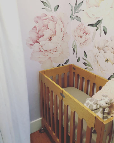 floral statement alma mini crib closet nursery