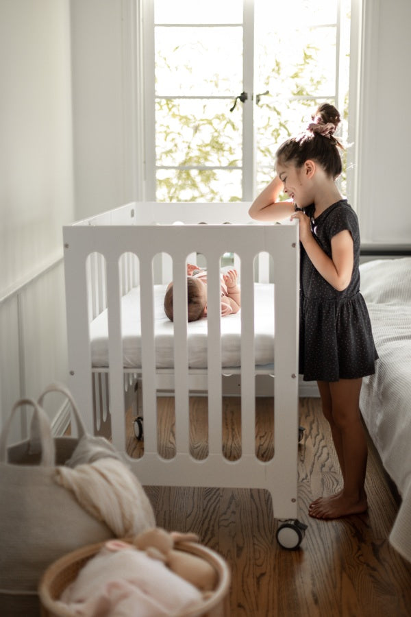 alma mini plus white crib with big sister