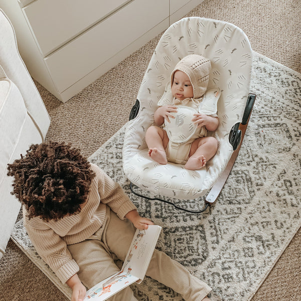 brother and baby in doves coco go bouncer