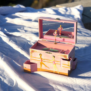 Ballet School Music box open view in sunshine | A ballerina is on top in pink with a posey and morning glories around her.  Scenes from the ballet studio are on the side.  Watercolor illustrations and 4 secret corner treasure drawers | Pretty musical gifts for kids from Enchantmints