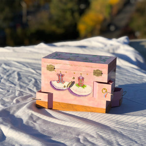 Ballet School Music box back view in sunshine | A ballerina is on top in pink with a posey and morning glories around her.  Scenes from the ballet studio are on the side.  Watercolor illustrations and 4 secret corner treasure drawers | Pretty musical gifts for kids from Enchantmints