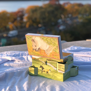 Hideaway horse music box back view open in sunshine | Musical treasure boxes and decor for kids from Enchantmints | beautiful gifts for horse lovers with white horse and farmscape in watercolor graphics
