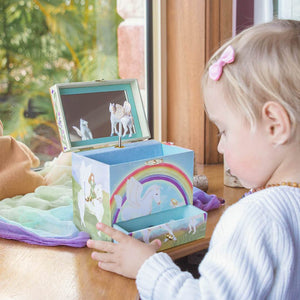 Pegasus rainbow music box with small blond girl with pink bow in hair | Musical treasure boxes and decor for kids from Enchantmints | unusual gifts for girls