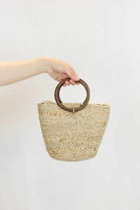Zara woven crossbody bag with an inner fabric pouch, close-up view.