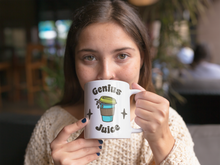 "Load image into Gallery viewer, Girl drinking a mug that says ""Genius Juice"" on it with an image of a pop-art take-away coffee mid-spill."