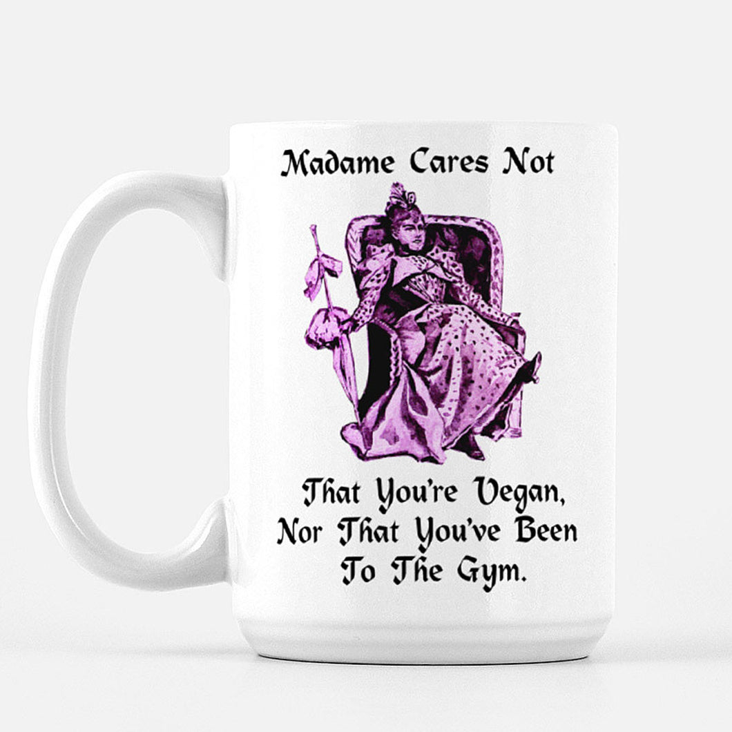 White Mug with Victorian Woman reclining in a chair that says: Madame Cares Not That You Are Vegan, Nor That You've Been To The Gyn