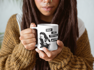 "Cool pierced chick holding a mug with a yelling black and white illustration of Xena that says ""Shut Yer Twitter Mouth"""
