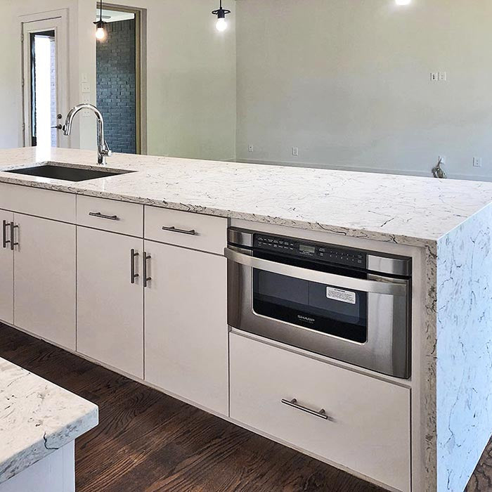 waterfall island with white cabinets