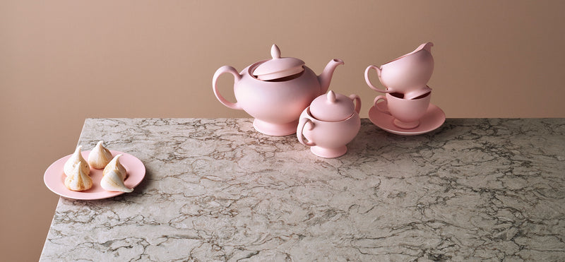 pink teacups on top of moorland fog countertops from caesarstone