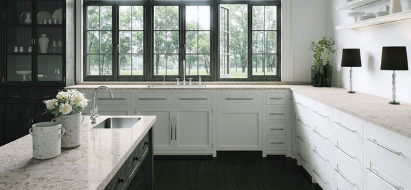 white kitchen cabinets with moorland got countertops from caesarstone