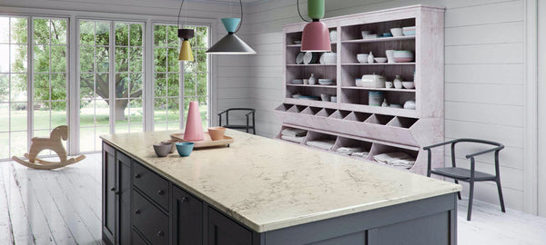 dark grey island cabinets with noble grey countertop from caesarstone