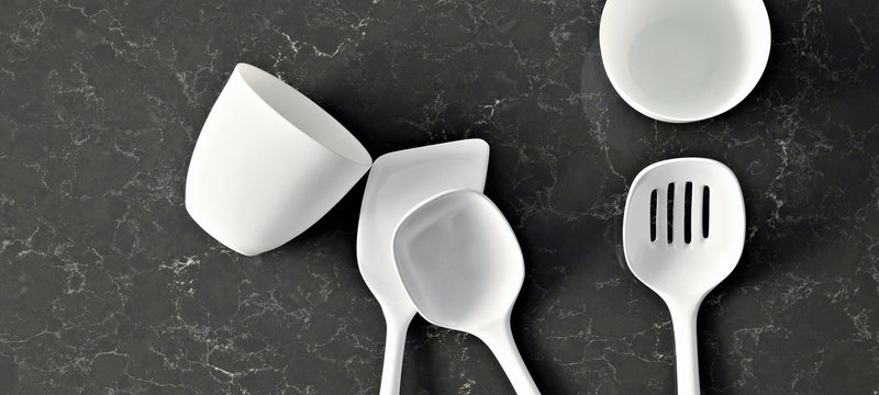 white cups and spoons on piatra grey countertops