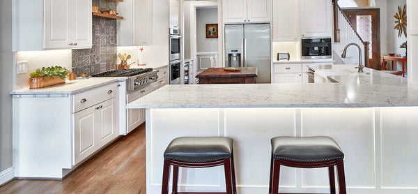 white attica countertops with white kitchen cabinets