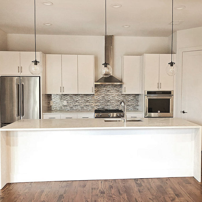 quartz waterfall kitchen island with white cabinets