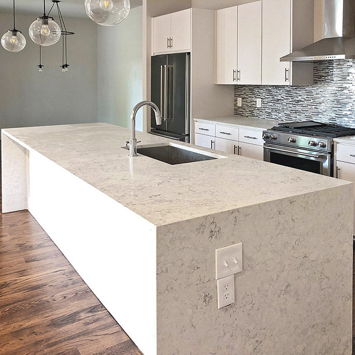 waterfall kitchen island with arctic ivory quartz