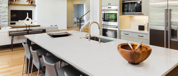 calacatta alto quartz countertops with white kitchen cabinets