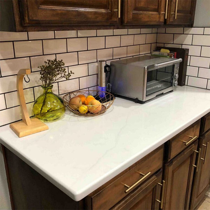 calacatta quartz with white subway tile