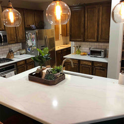 white calacatta quartz with brown cabinets