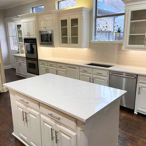 white cabinets with calacatta quartz countertops