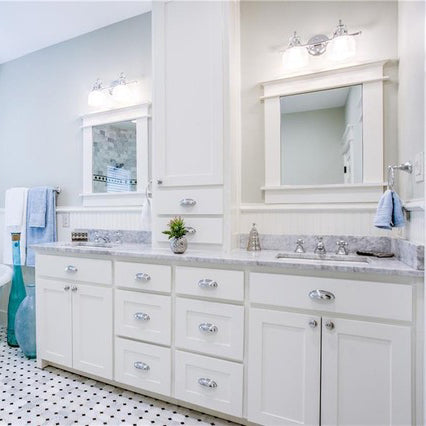 carrara marble bathroom countertops with white rectangular sinks and white cabinets