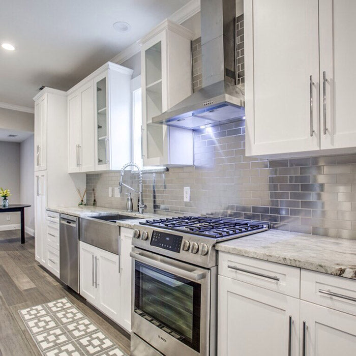 hite kitchen cabinets with fantasy brown granite countertops and stainless steel farm sink, aluminum backsplash subway tile