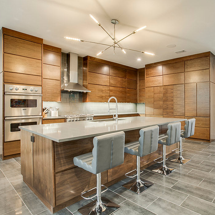 light brown cabinets with grey quartz countertops
