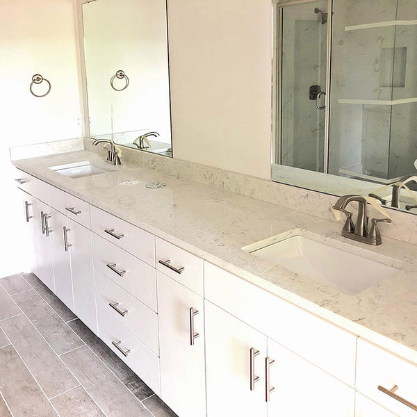 white cabinets with quartz vanity tops and white rectangular sink
