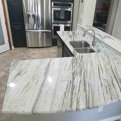 light grey granite with dark color cabinets