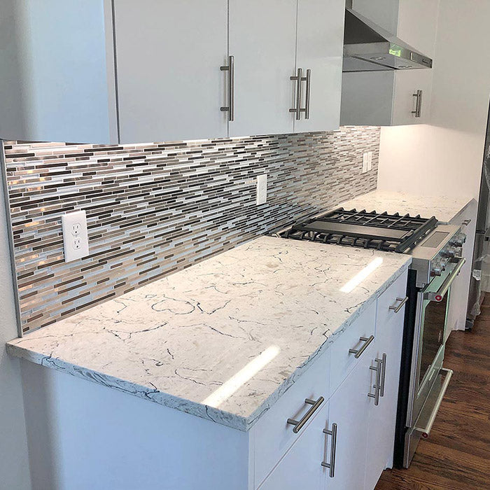quartz countertops on white cabinets