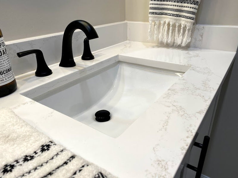 bathroom vanity with starto hanstone quartz countertops and white rectangular sink