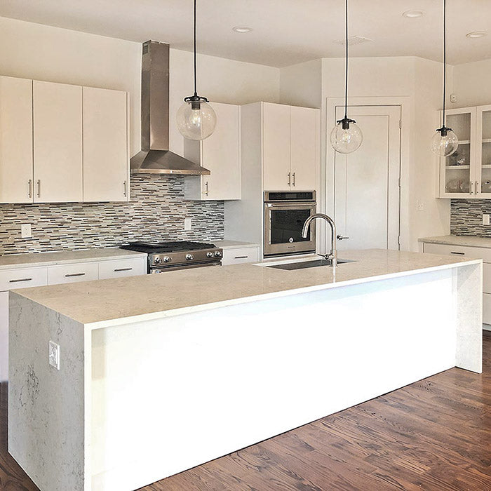white kitchen cabinets with arctic ivory quartz countertops kitchen