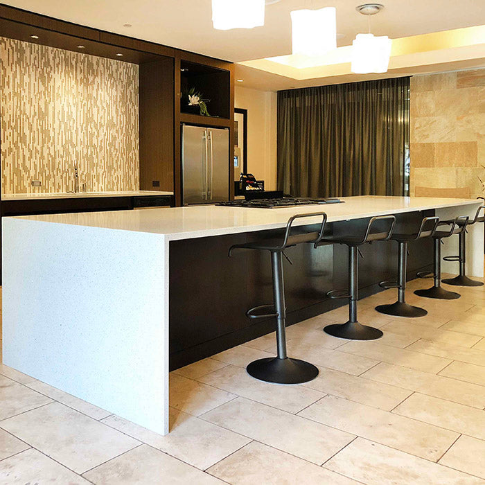 wahite sparkle quartz countertops with waterfall island