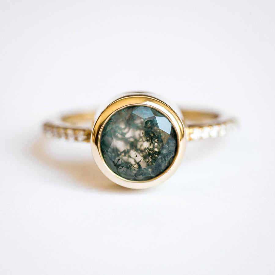 Planet ring set with Moss Agate