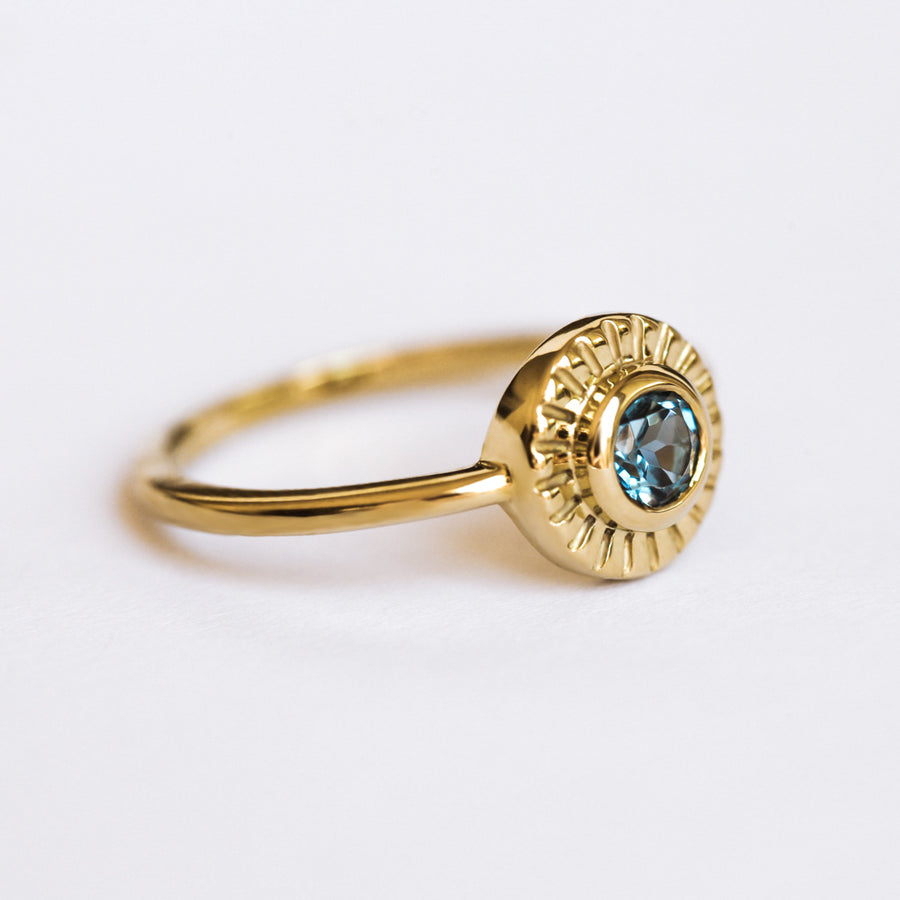 Sunset Ring set with London Blue Topaz and Moissanite
