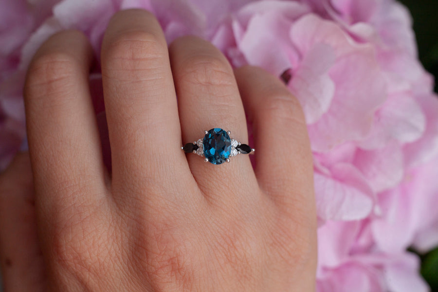 Lauryn Oval London Blue Topaz Ring with Moissanite and Black Spinel