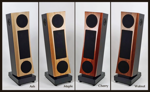 Four JansZen Valentina electrostatic loudspeakers showing the four baffle wood species