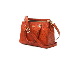 Orange ostrich look leather handbag, side view