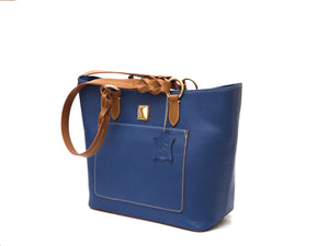 Blue zippered leather tote bag with tan straps, side