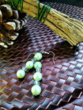 Pearlescent green and white beaded earrings