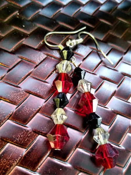 Ruby drop earrings with black and clear accents