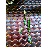 Green feather beaded earrings