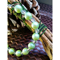 Pearlescent green and white beaded bracelet