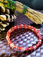 Wrist coil beaded bracelet, red with stainless steel accents