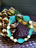 Teal and white beaded bracelet