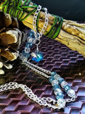 Blue and clear beaded necklace with crystaline snowflake
