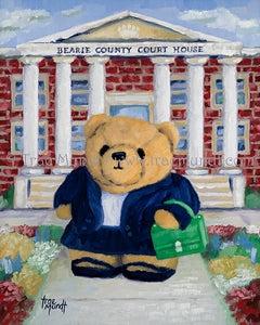 Justine Teddy Bear Art Print by Trae Mundt. Golden teddy bear is a lawyer dressed in a blue suit jacket and skirt holding a kelly green breifcase standing in front of brick court house with flowers in the garden in front of the building.